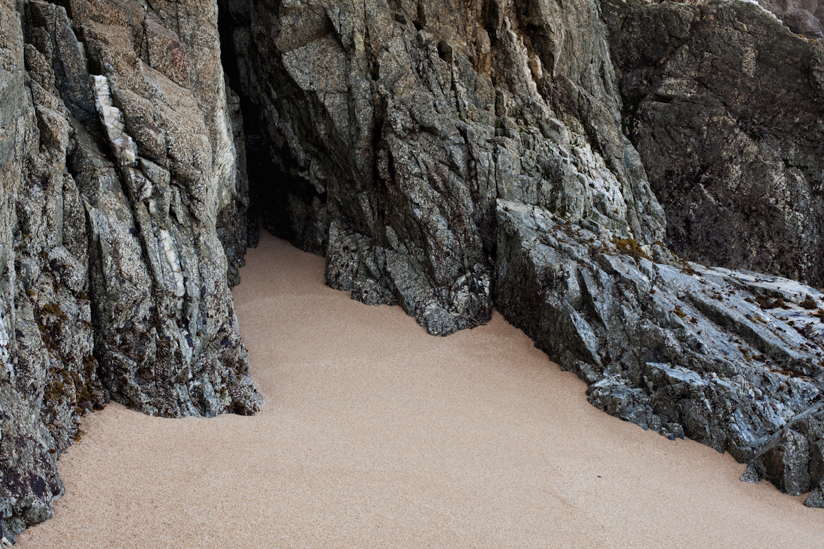 color photograph rocks and sand looks like a large cave